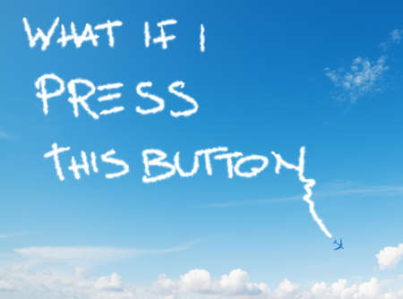 what if: what if i press this button written in the sky with contrails left by airplane Stock Photo