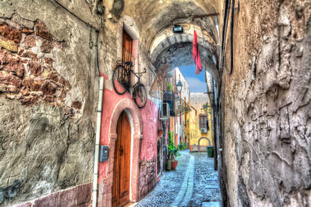 backstreet: Picturesque backstreet in Bosa, Italy. Heavy processed fot hdr tone mapping effect. Stock Photo