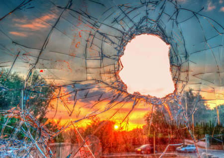 sabotage: Broken glass by the street at dusk. Processed for hdr tone mapping effect