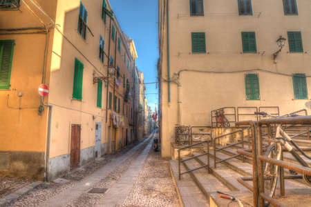 backstreet: glimpse of a backtreet in Alghero old town. Heavy processed for hdr tone mapping effect.