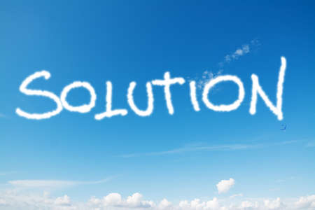 problemsolving: solution written in the blue sky Stock Photo