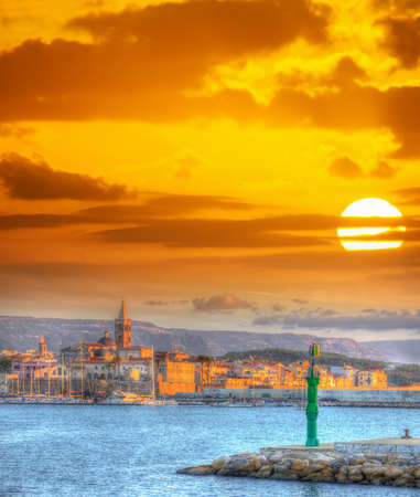 bright sun over Alghero at sunset
