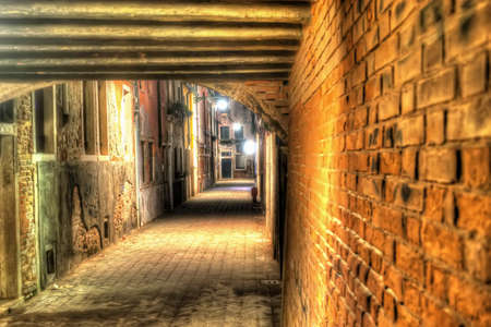 backstreet: narrow backstreet in Venice at night. Processed for hdr tone mapping effect. Stock Photo