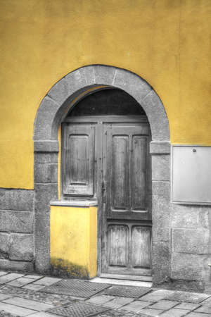 old wooden door in Bosa, Italy. Processed for selective desaturation effect. photo