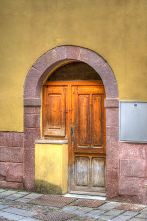 old wooden door in Bosa, Italy. Processed for hdr tone mapping effect. photo