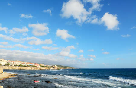 windy: Alghero rocky coast on a windy day with clouds Stock Photo