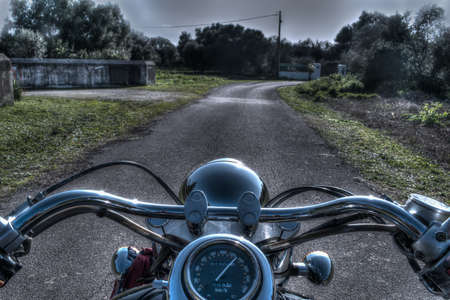 classic motorcycle on a country road in hdr tone mapping Standard-Bild