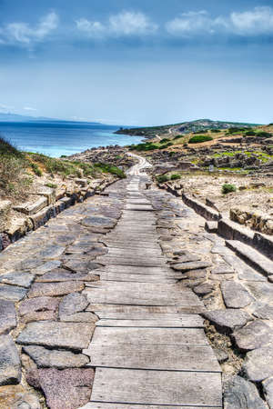 stone road: path made with stones and wood in Tharros archaeological site