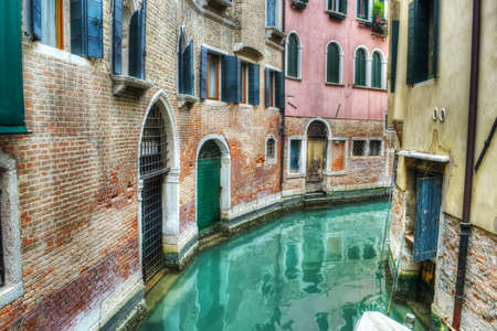 venice: narrow canal in Venice, Italy