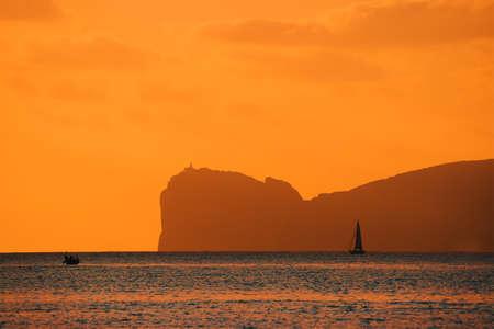 capo: orange sunset over Capo Caccia, Italy Stock Photo