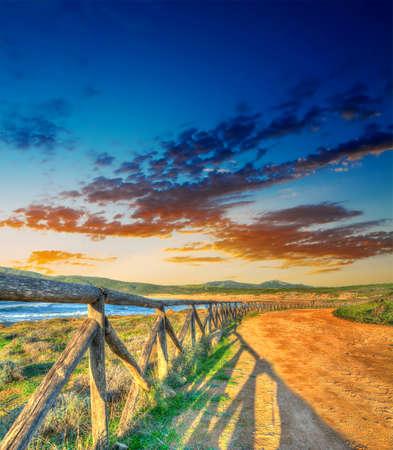 colorful sunset by Porto Ferro shoreline. Shot in Sardinia, Italy photo