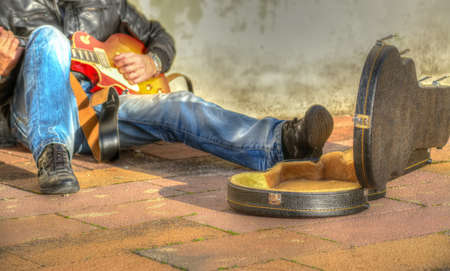 guitar case: guitar player in the street with an open guitar case