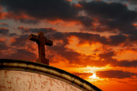 holy cross under a colorful sky at sunset photo