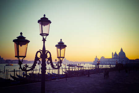urban architecture: classic lamppost in San Marco square at sunset. Shot in Venice, Italy. Processed for vintage tone effect.