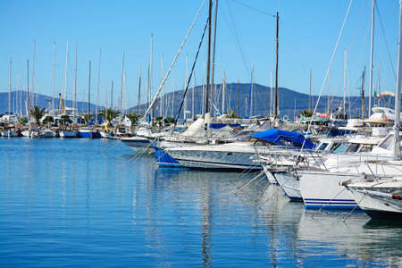 boats in Alghero harbor on a clear day. Shot in Sardinia, Italy