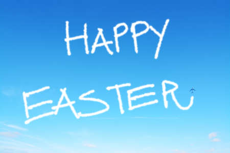 sky: happy easter written in the sky with contrails Stock Photo