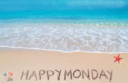 happy monday written on a tropical beach