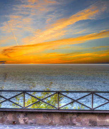 balustrade: metal balustrade by the shore. Processed for hdr tone mapping effect Stock Photo