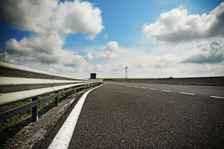 vignetting: road under a cloudy sky with vignetting effect