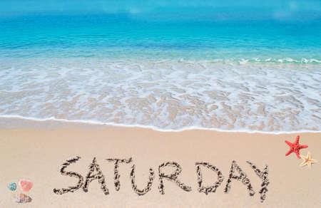 saturday: saturday written on a tropical beach