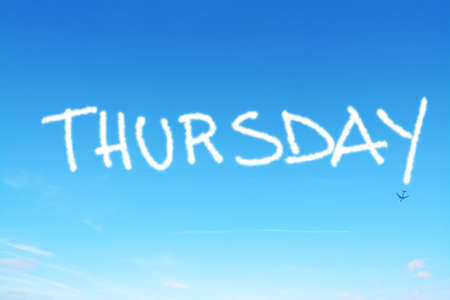 thursday: thursday written in the sky with contrails Stock Photo