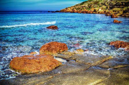 mapped: red rocks in Castelsardo shoreline. Processed for hdr tone mapping effect Stock Photo