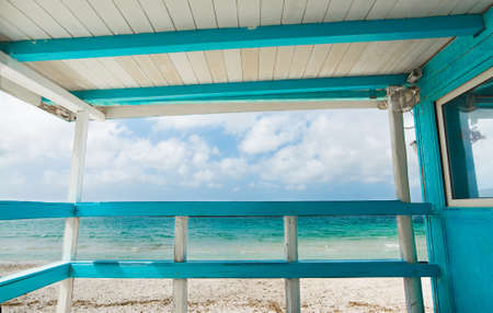 turquoise: white and turquoise wooden terrace by the shore. Shot in Sardinia, Italy Stock Photo