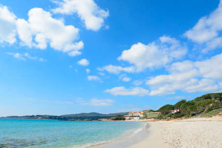 spring tide: white clouds over Le Bombarde beach, Sardinia Stock Photo