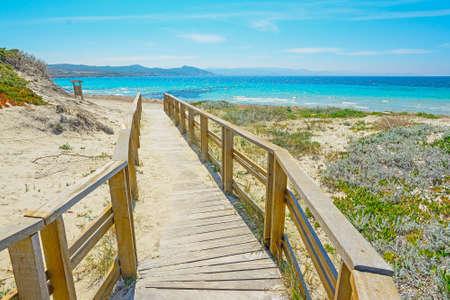 wooden boardwalk to the beach in Capo Testa, Sardinia