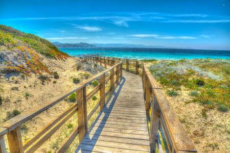 hand rail: wooden boardwalk in Capo Testa, Sardinia