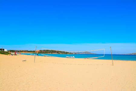 beach volley: beach volley net and rubber boats in Porto Pollo, Sardinia