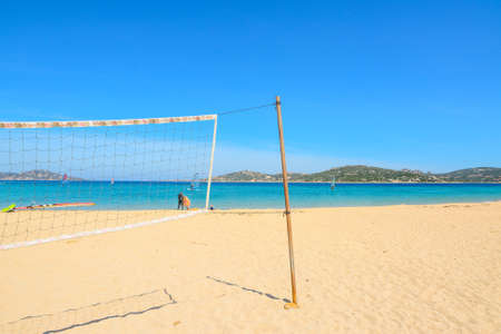 beach volley: beach volley net and surfboards in Porto Pollo beach, Sardinia Stock Photo