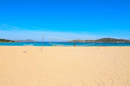 beach volley: beach volley net and surfers in Porto Pollo beach, Sardinia Stock Photo