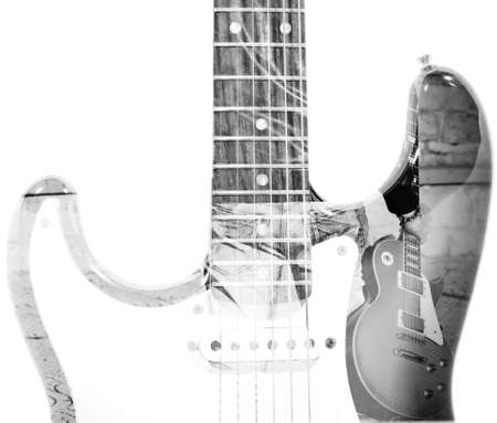 back view of a man holding a guitar and guitar silhouette in double exposure in black and white photo