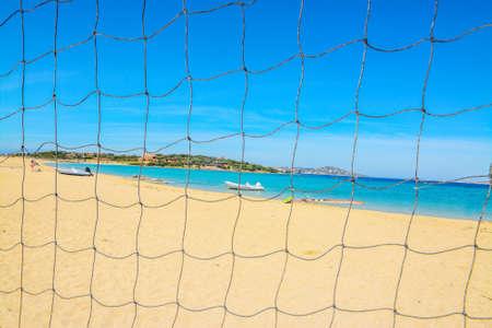 beach volley: golden beach seen through a beach volley net