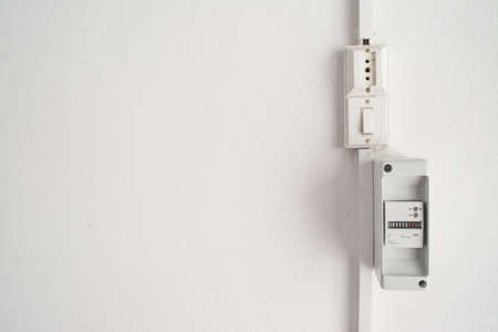 electricity meter: electricity meter in a white wall with copy space