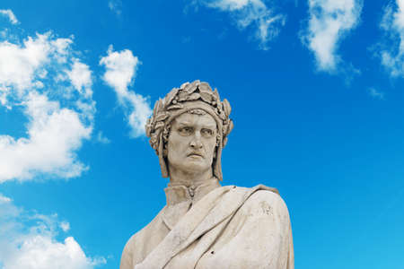 dante alighieri: dante alighieri statue under a blue sky with clouds