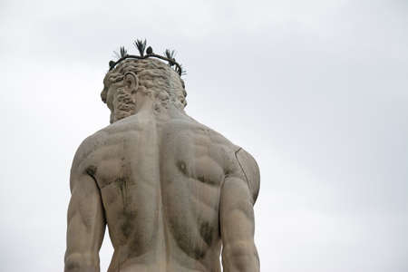 signoria square: back view of Neptune statue in Piazza della Signoria in Florence, Italy Stock Photo