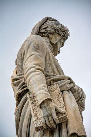 dante alighieri: Dante Alighieri statue in Santa Croce square in Florence, Italy