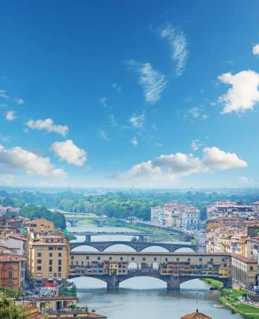 colorful sky: Ponte Vecchio and other bridges over Arno river in Florence, Italy Stock Photo