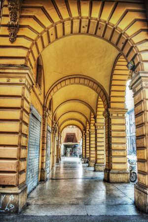 bologna: yellow arcade in Bologna, Italy