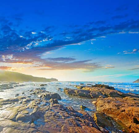 ferro: colorful sunset in Porto Ferro, Sardinia Stock Photo