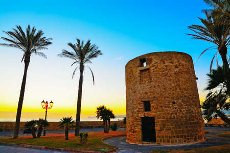 sighting: antique sighting tower by the sea in Alghero, Sardinia Stock Photo