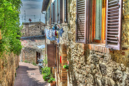 the silence of the world: narrow road in San Gimignano in hdr tone mapping effect Stock Photo