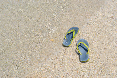 foreshore: flip flops on a sandy beach by the foreshore