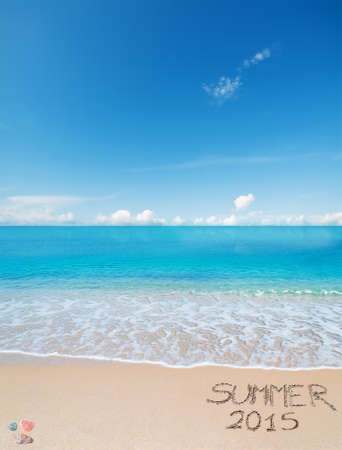sand writing: turquoise water and golden sand in Sardinia with summer 2015 writing