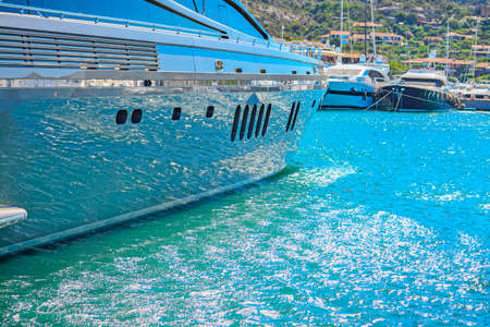 water reflected on a yacht hull in Porto Cervo harbor, Sardinia