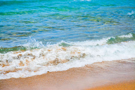 foreshore: small wave by a golden foreshore in Sardinia