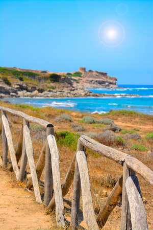 palisade: perspective view of a wooden palisade by the sea in Sardinia, Italy Stock Photo
