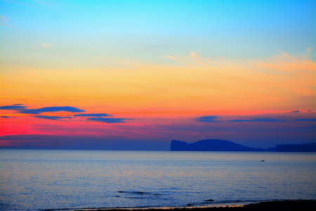 beautiful scenery: colorful sky over Capo Caccia at dusk, Italy Stock Photo